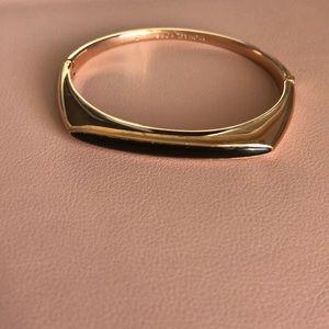 Micheal Kors gold with black bracelet